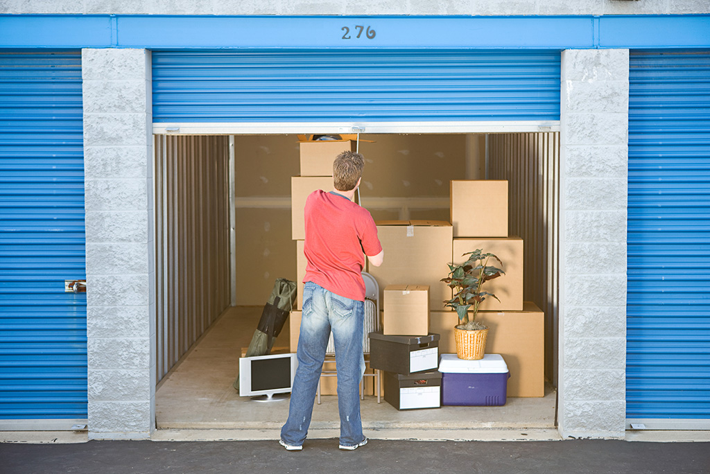 man at storage unit