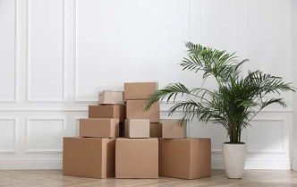 moving boxes against a wall