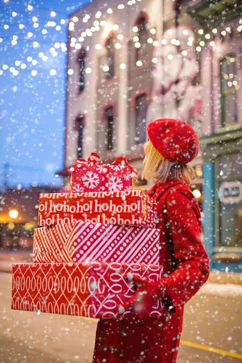 woman carrying christmas presents
