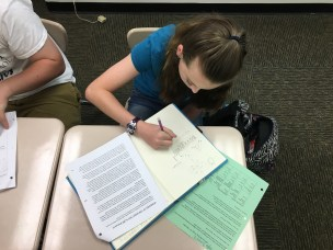 Students sketch while listening to mentor texts