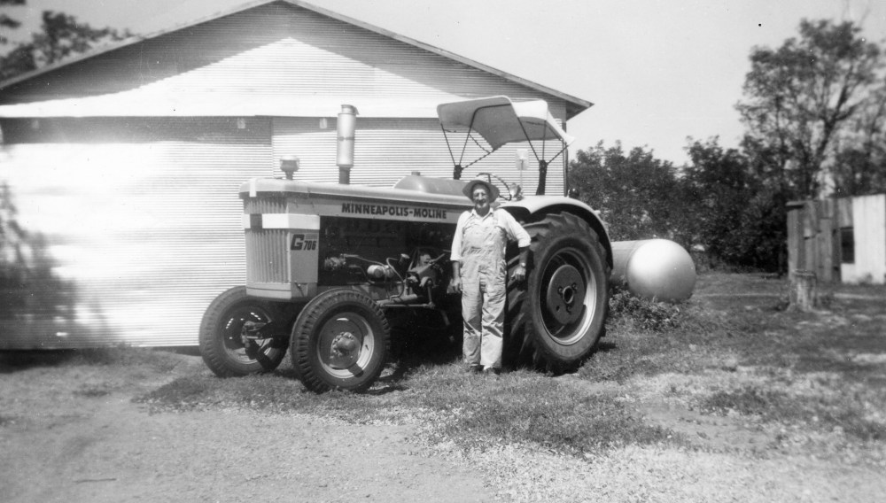 George Price with his Minneapolis-Moline tractor, 1964