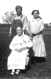 My Grandfather was the one who mowed his yard with a horse.  Shown here with 4 generations: my Grandfather, Great Grandmother, and my Great Great Grandmother Baugher is holding my mother.  1930.