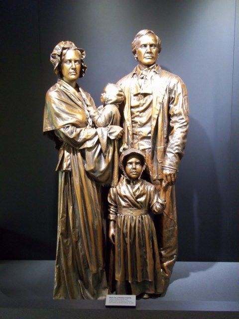 "Statue of the Lincoln family, with Mary Hanks Lincoln holding Abraham. In 1851, he was quoted as saying, Abraham said of his mother, ""God bless my mother; all that I am or ever hope to be I owe to her."""