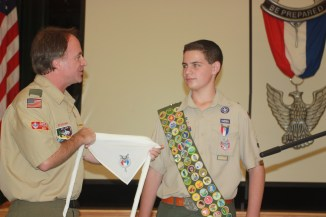 Presenting a National Eagle Scout Association neckerchief is a great addition to the ceremony.