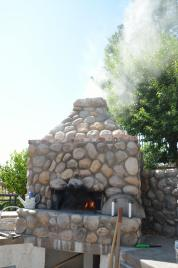 Lots of smoke can be generated by wet wood, or a wet chimney.