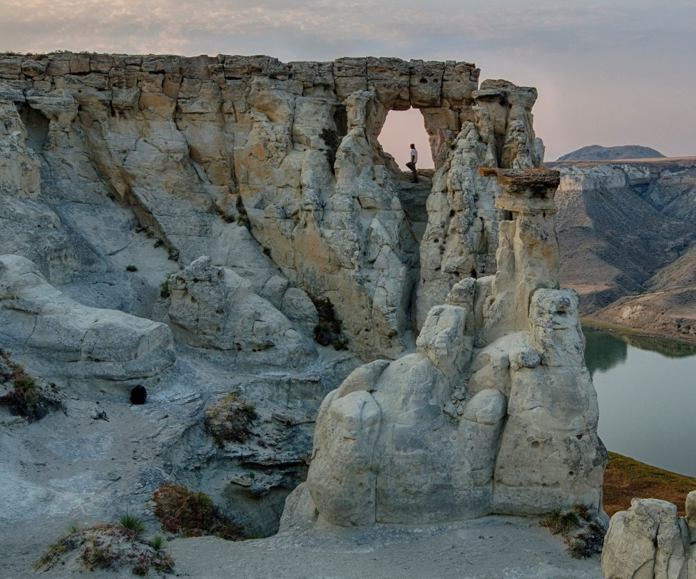 "This photo by Bob Wicks (mypubliclands.tumblr.com) from the Upper Missouri Rivers Breaks National Monument in Montana is an example of the use of use of framing to add a sense of intrigue to the image by blocking part of the view – Viewers will look at the person in the ""Hole in the Rock"" and wonder what that individual is seeing. To access the Hole in the Rock and other amazing photogenic rock formations, one must take a multi-day float trip down the Upper Missouri Wild and Scenic River. You will be following the same route (albeit going downstream) that Lewis and Clark came up on their voyage of discovery. The Upper Missouri River Breaks National Monument hold a spectacular array of plant life, wildlife, unique geological features, endless recreational opportunities and significant historical and cultural values. The 149-mile Upper Missouri National Wild and Scenic River flows through the monument. The land and the rugged, surrounding uplands (commonly call the Missouri Breaks) are defined in part by their history."