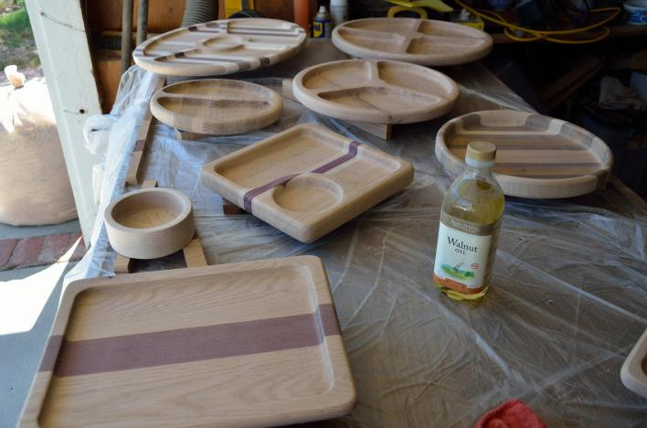 Round 2 of the routed bowls, in their raw, unfinished state. All will be coated in walnut oil. Yes, that's a big bag of sawdust on the left side of the photo.