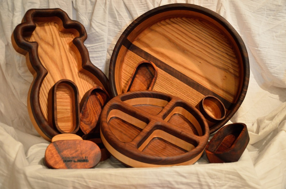 You can never just make just one. Most of these pieces are walnut and red oak. The 4 section bowl is walnut and hard mable. The all brown small, oblong bowls are koa.