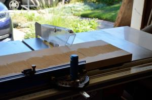 Here's the table saw ready to do a crosscut on a hard maple plank.