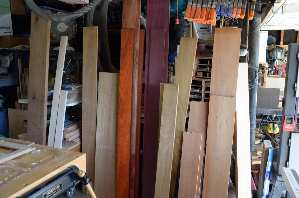 Here we have the largest variety of hardwood I've ever had in the shop. From left, there is black walnut, hard maple, canarywood, mahogany, padauk (the orange one), purpleheart, African teak and cherry.
