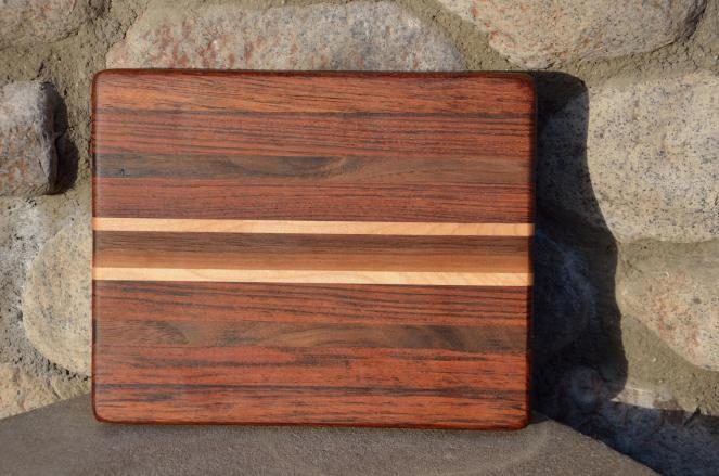 # 11 Cheese Board, $35. Jatoba, Hard Maple, Walnut.