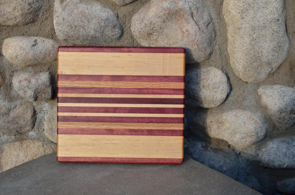 # 18 Cheese Board, $40. Edge grain. Purpleheart, Hard Maple and (this one has) Red Oak. I'm no longer using Red Oak in this design.