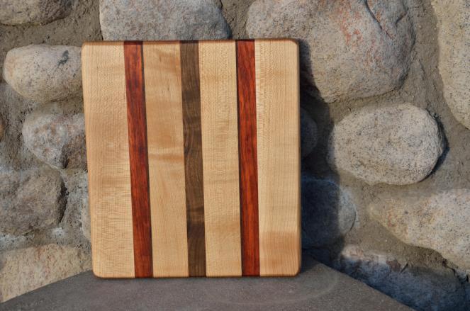 # 7 Cheese Board, $30. Hard Maple, Padauk, Walnut.