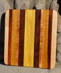 # 4 Cheese Board, $40. Hard Maple, Tigerwood, Teak, Walnut, Yellowheart.
