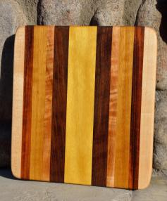 # 4 Cheese Board, $40. Hard Maple, Tigerwood, Teak, Walnut, Yellowheart.