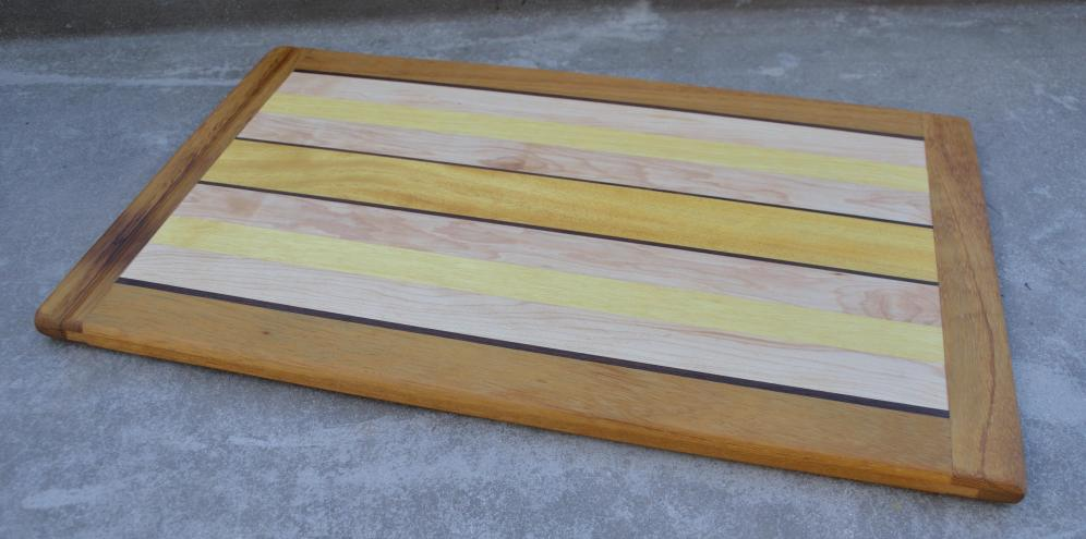 Commissioned work, replacing a pull-out cutting board in the client's kitchen. African Teak, Walnut, Hard Maple, Yellowheart. Cutting Board # 10.