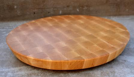 "# 77 Cutting Board, $150. Hard Maple, End grain. 16"" diameter, 20 degree cant to the edge."