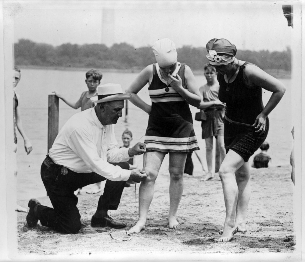Beach rules require bathing suits be within 6 inches of the knee. Here, an inspector is enforcing that rule. 1922. Photo by Herbert E French. Prints and Photographs Division, Library of Congress.