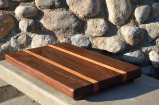 # 15: Walnut and Honey Locust. Chamfered bottom edge in place of handholds on each end.
