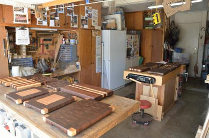 I've got 2 real work surfaces: the workbench (to the right) and my table saw with a protective cover on it (to the left). When the saw is covered ... well, no sawing is happening. That leaves my workbench and whatever flat surface I can find to store things.
