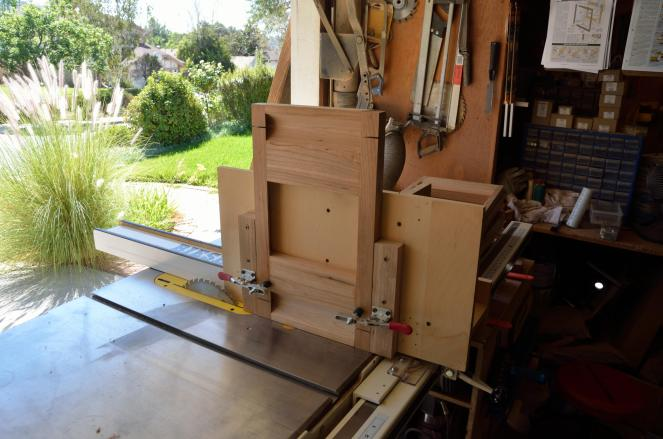A tall auxilary fence on the table saw makes this vertical cut a snap.