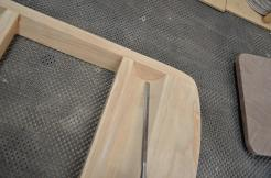 Nothing beats a sharp chisel for cleaning up hardened glue in a complex shape.