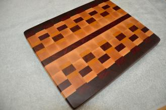 "# 69 Cutting Board, $125. Black Walnut, Hard Maple, Padauk and Yellowheart. 15-1/4"" x 12-1/4"" x 1-1/8"". End grain."