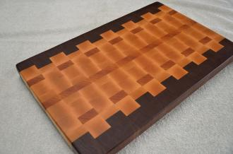 "# 67 Cutting Board, $125. Black Walnut, Hard Maple and Cherry. 20"" x 12-1/2"" x 1-1/2"". End grain."