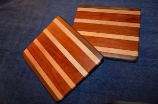 "# 25 Cutting Board, $50. Edge grain. Walnut, maple and cherry. 12"" x 8""."