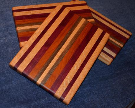 "Edge grain. Oak, purpleheart, cherry and walnut. 11"" x 8"" x 1""."
