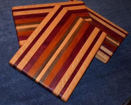 "Edge grain. Oak, purpleheart, cherry and walnut. 11"" x 8"" x 1""."