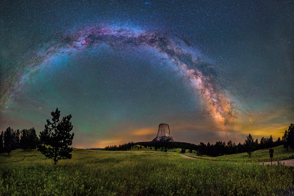 """America's first national monument, Devils Tower is a geologic feature that protrudes out of the rolling prairie in Wyoming. David Lane captured this amazing 16-image panorama of the monument illuminated by the Milky Way and green airglow. Of visiting Devils Tower, David says: """"From ancient stories of the Pleiades taking refuge at the top to the generations of Native Americas that held it sacred, it had a deep sense of age and a stoic nature that impressed me. It's so unexpected, so large in person, so steeped in traditions."""" Posted on Tumblr by the US Department of the Interior, 11/13/14."""