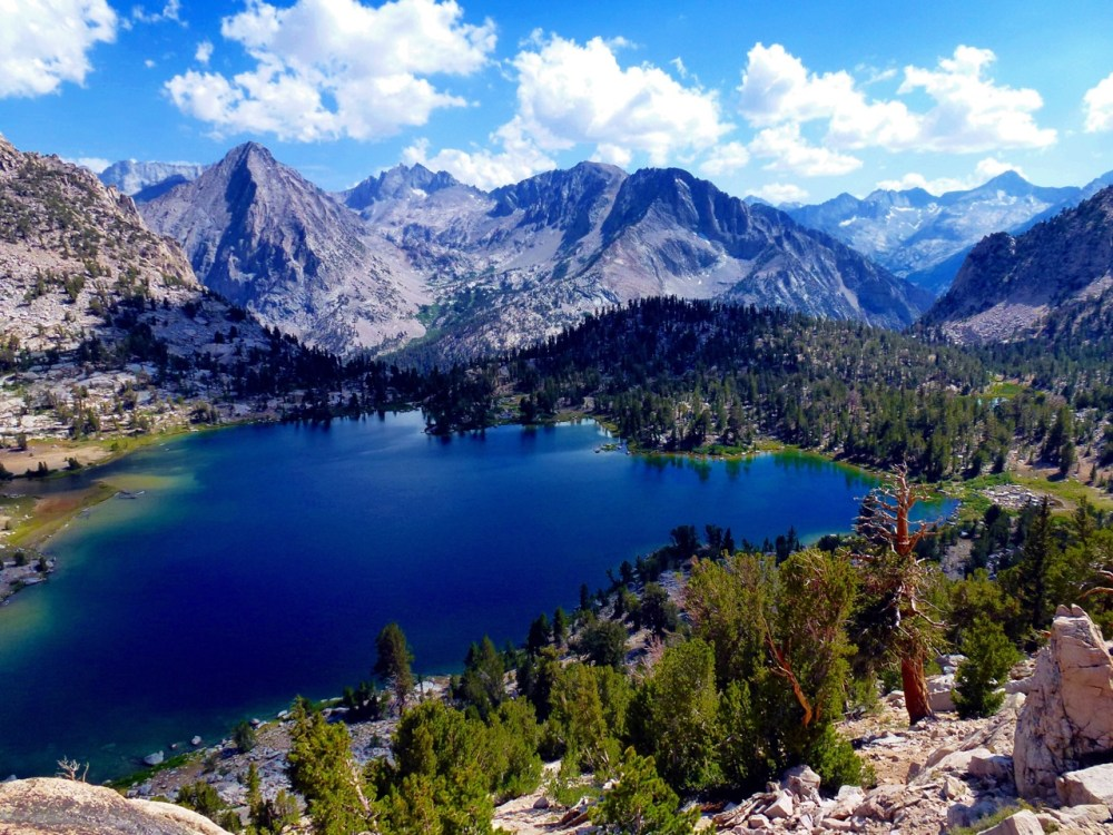 Kings Canyon National Park in California testifies to nature's size, beauty and diversity with huge mountains, rugged foothills, deep canyons, vast caverns and the world's largest trees. The park lies side-by-side to Sequoia National Park in the southern Sierra Nevada. This Veterans Day, you can visit to all national parks, wildlife refuges and other public lands for free. Pictured here is Bullfrog Lake by David Palefsky. Posted on Tumblr by the US Department of the Interior on 11/14/14.