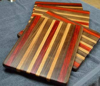 "A set of 4x cheese boards. Black Walnut, Red Oak and Padauk. Each is 8"" x 10"" x 3/4"". Already sold."
