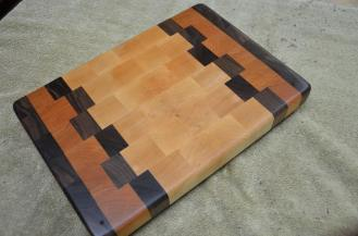 "Black Walnut, Cherry and Hard Maple end grain. 8"" x 12"" x 1""."