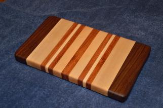 "Edge grain small board. Black Walnut, Hard Maple and Jatoba. 7"" x 12"" x 1""."