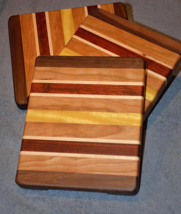 """Cheese Board # 15 - 011. Black Walnut, Cherry, Hard Maple, Padauk and Yellowheart. 8"""" x 9"""" x 1""""."""