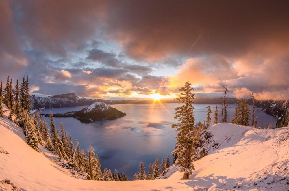 Crater Lake National Park. Greg Nyquist captured this stunning shot from Discovery Point just as a storm was clearing the park. Discovery Point is a popular place to watch the sun rise over the park with views of the lake and Wizard Island. Tweeted by the US Department of the Interior, 2/5/15.