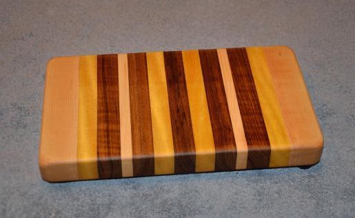 "Small Board # 15 - 022. Hard Maple, Yellowheart and Teak. 7"" x 12"" x 1-1/2""."