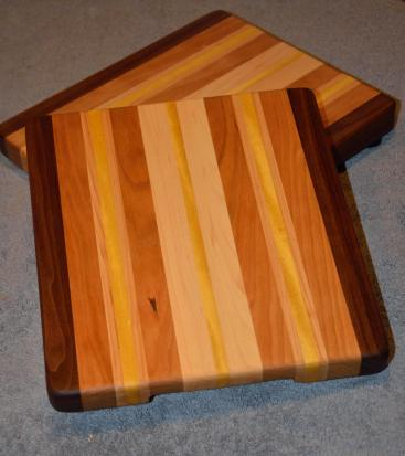 """Small Board # 15 - 023. Black Walnut, Cherry, Yellowheart and Hard Maple. 11"""" x 12"""" x 1-1/4"""". Sold after about 2 months of showings."""