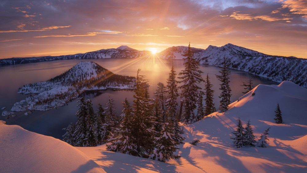 A brilliant sunrise illuminates a fresh blanket of snow at Oregon's Crater Lake National Park. To capture this amazing shot of the sun peeking over the rim of the lake, Alex Noriega had to snowshoe for miles to the park's west rim, and the extra effort paid off. This photo, taken February 2015, includes views of Wizard Island, Mount Scott and Garfield Peak. Photo courtesy of Alex Noriega. Posted on Tumblr by the US Department of the Interior, 3/22/15.