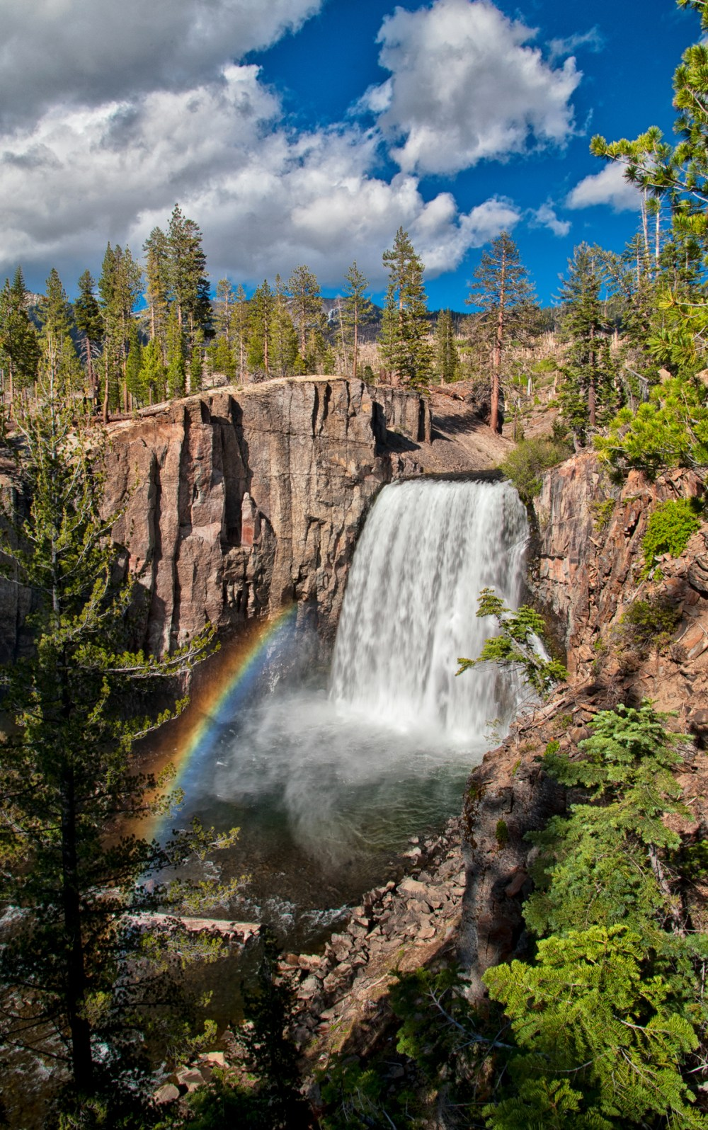 Here's a great pic of a rainbow at the end of Devils Postpile National Monument's iconic Rainbow Falls. Plunging 101-feet down to the turbulent water below, the falls are aptly named for the many rainbows that appear in its mist throughout sunny summer days.  Photo by Cat Connor. Posted on Tumblr by the US Department of the Interior, 3/17/15.