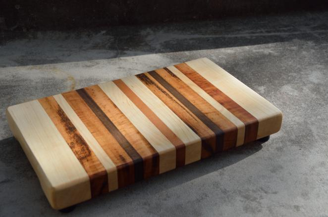 "Small Board # 15 - 030. 7"" x 12"" x 1-1/2"". Hard Maple, Goncalo Alves (AKA Tiger Wood) and Walnut."