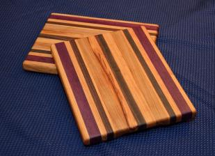 "Cheese Board # 15 - 018. Honey Locust, Purpleheart, Black Walnut and Cherry Edge Grain. 9"" x 11"" x 3/4""."