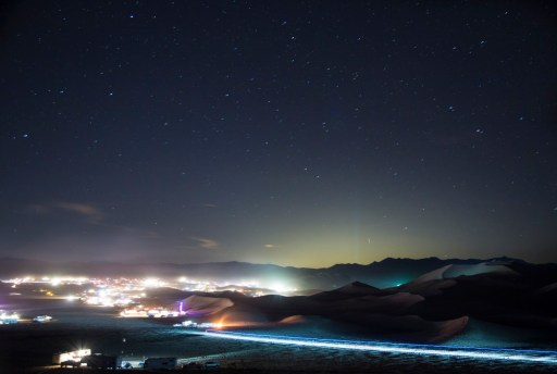 The lights seen from Dumont Dunes Off-Highway Vehicle Area, in California. Photo by Bob Wick. Posted on Tumblr by the US Department of the Interior, 4/10/15.