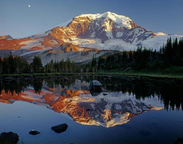 At more than 14,000 feet, Mount Rainier stands as an icon in the Washington landscape, while the wildflower meadows and forests that ring the peak offers visitors a great place to explore. This beautiful shot of Mount Rainier – showing a sunset reflection in a lake – was taken from the north side of the peak along the Moraine Park Trail. Photo by Ed Cooper. Tweeted by the US Department of the Interior, 6/5/15.