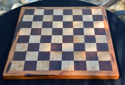 Chess Board # 02. Black Walnut & Hard Maple squares with a Goncalo Alves border ... AKA Tiger Wood. Perfect for spirited games.