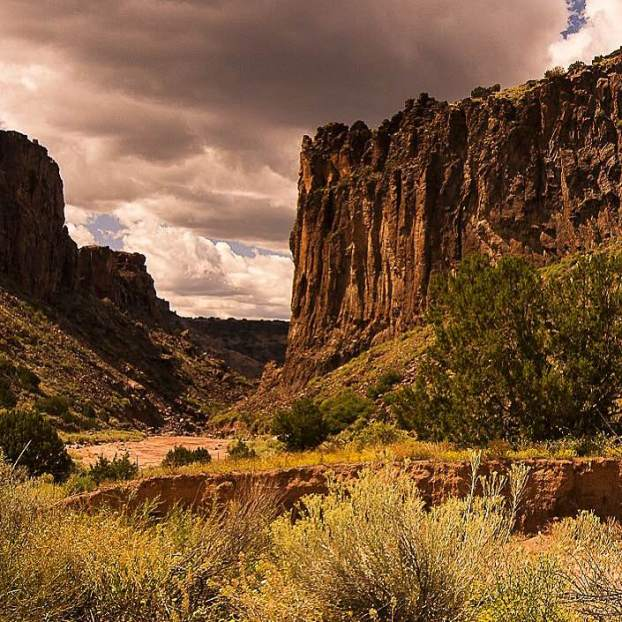 Dark clouds & tall rock cliffs make for a dramatic shot of New Mexico's Diablo Canyon. Photo by Steven W Marti. Tweeted by the US Department of the Interior, 8/14/15.