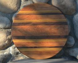 "Lazy Susan 15 - 013. Hard Maple, Yellowheart, Teak and Black Walnut. Lovely grain on this one - this dark brown Hard Maple came from a single plank, and the grain is matched across the piece. 17"" diameter."