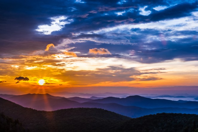 """A magnificent sunrise at Blue Ridge Parkway. This stunning photo was taken by Eric Allen Van Tassel at the East Fork Overlook on the North Carolina side of the Parkway. Feeling lucky to stumble upon the overlook at the right time, Eric is still hesitant to show it off because """"I felt the product does not reflect the overwhelming beauty and the excitement we experienced watching the sunrise that morning."""" We know the feeling, but think this photo is definitely worth sharing! Photo courtesy of Eric Allen Van Tassel. Posted on Tumblr by the US Department of the Interior, 9/17/15."""